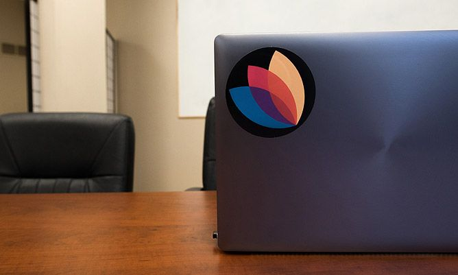 content bloom logo sticker on a laptop