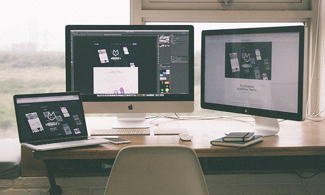 computer and laptop setup on a work desk
