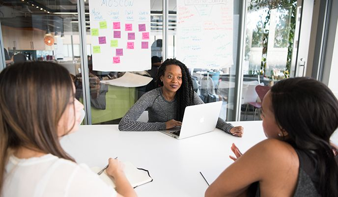 Account lead on web development team in board room