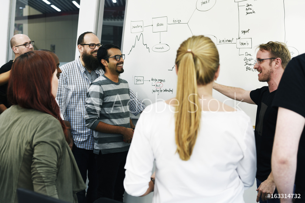 Team presenting on a whiteboard